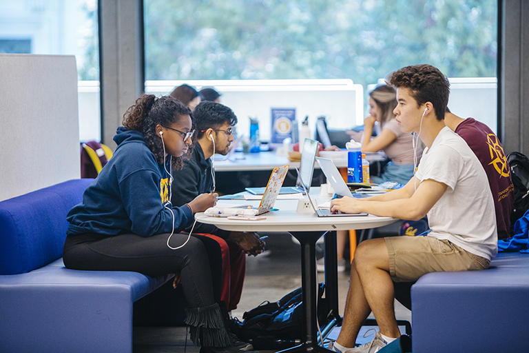 Students studying in Moffitt Library.