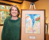 Rachel Morello-Frosch with award artwork for CAAIEE