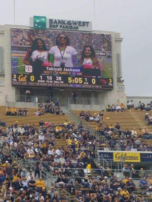 Takiyah Jackson, director of the African American Student Development program is honored by the Faculty Club for her work with Black student-athletes and Cal Athletics. Here she is seen on the jumbotron of the stadium as she received the award.